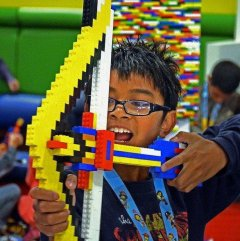Mason Eugenio, 11, plays with a bow he crafted from Legos at Legoland California in Carlsbad.