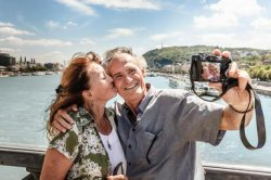 Older couple taking self portraits - Cultura/Dan Brownsword/Riser/Getty Images