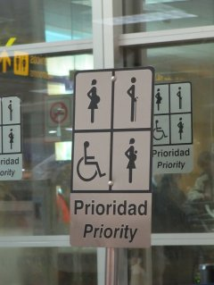 Priority parking sign depicting pregnant, elderly, or handicapped individuals