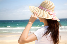 woman beach ocean hat summer travel relax